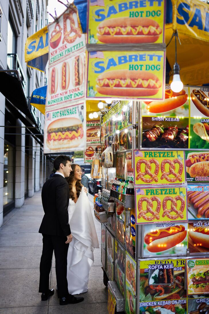 Couple Buying Hot Dog in Downtown New York City