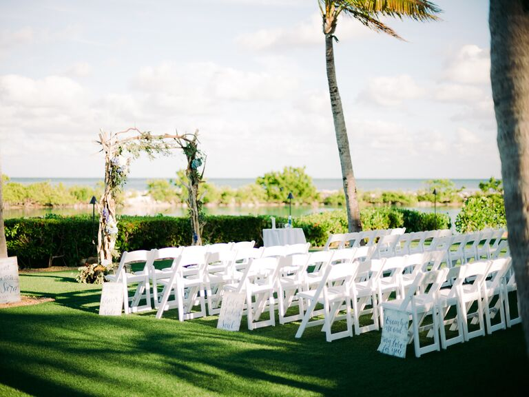 chairs on a lawn set up for wedding ceremony in florida