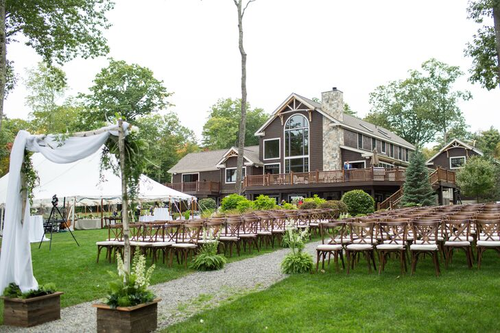 A Rustic-Natural Estate Ceremony with Draped Birch Arch and Cross-back Chairs