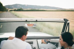 Bride and Groom Driving in Convertible