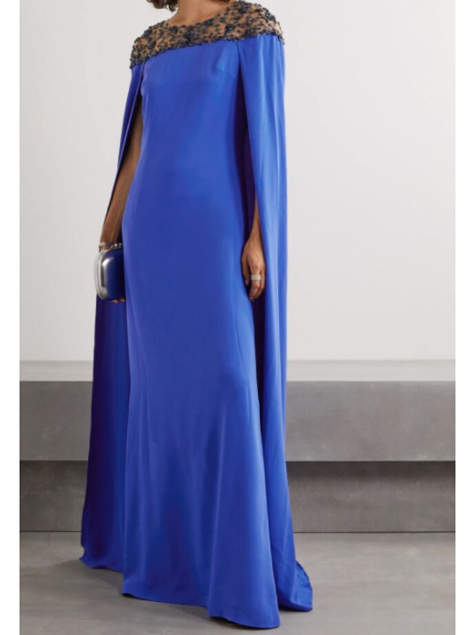 Royal blue dress with cape-like back and embellished neckline