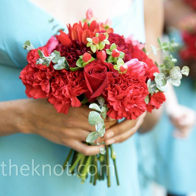 Red garden roses, tulips and dahlias popped against the bridesmaids' blue dresses, while sprigs of blue eucalyptus tied in perfectly with the fabric.