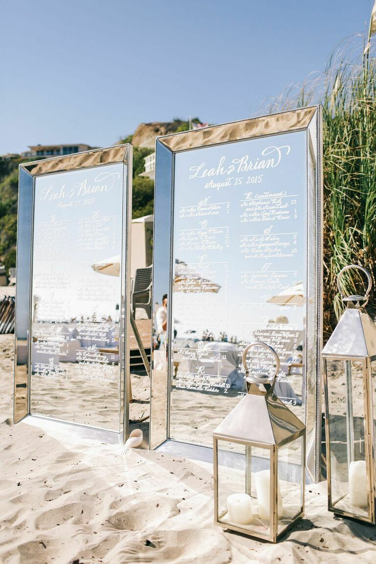 Two mirrored seating charts on the beach