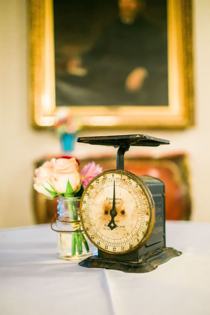 "Melissa and Jonathan wanted their decor to do more than dress up the halls of the Grant-Humphreys Mansion, they wanted each element to tell a unique story about their families' histories. The pair collected antique and vintage details from their family members, including books, cameras, vases, medicine bottles and more to inject personality into each and every one of the centerpieces. ""In every detail we hoped to build off the beauty of the past to make our future,"" says Melissa."