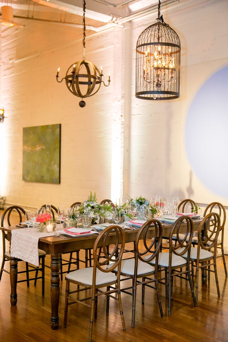After the ceremony, the industrial space inside Terra Gallery in San Francisco, California, was transformed for the reception. Long wooden farm tables draped with white linens seated guests for an evening's meal, filled with various types of cuisine—including Tex-Mex, which Chelsea and Chris absolutely loved.