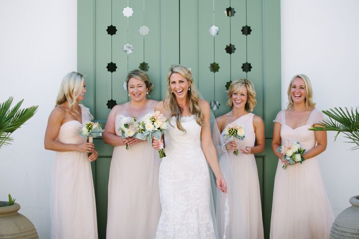 The bridesmaids wore floor-length chiffon  dresses from Bella Bridesmaids with different straps.