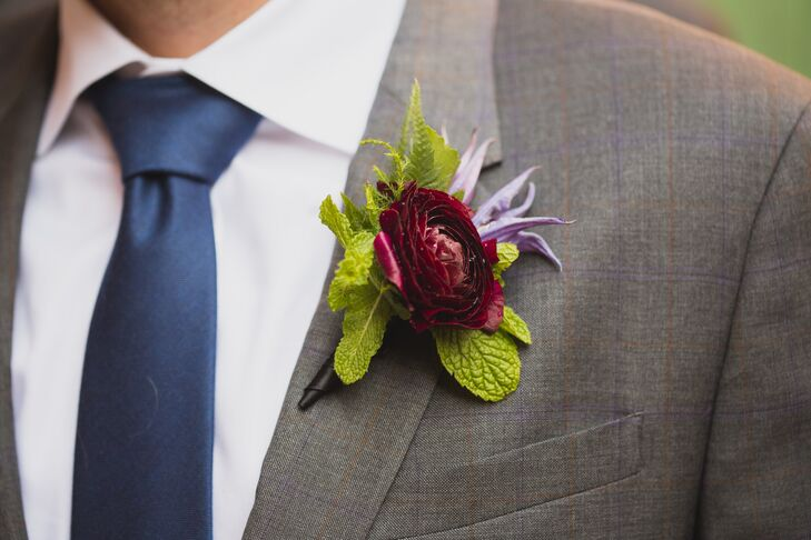 Bernard's wedding day attire was accentuated by his deep purple boutonniere. Instead of having a wedding party, it was just Tess, Bernard and the bride's sister, who officiated the ceremony.
