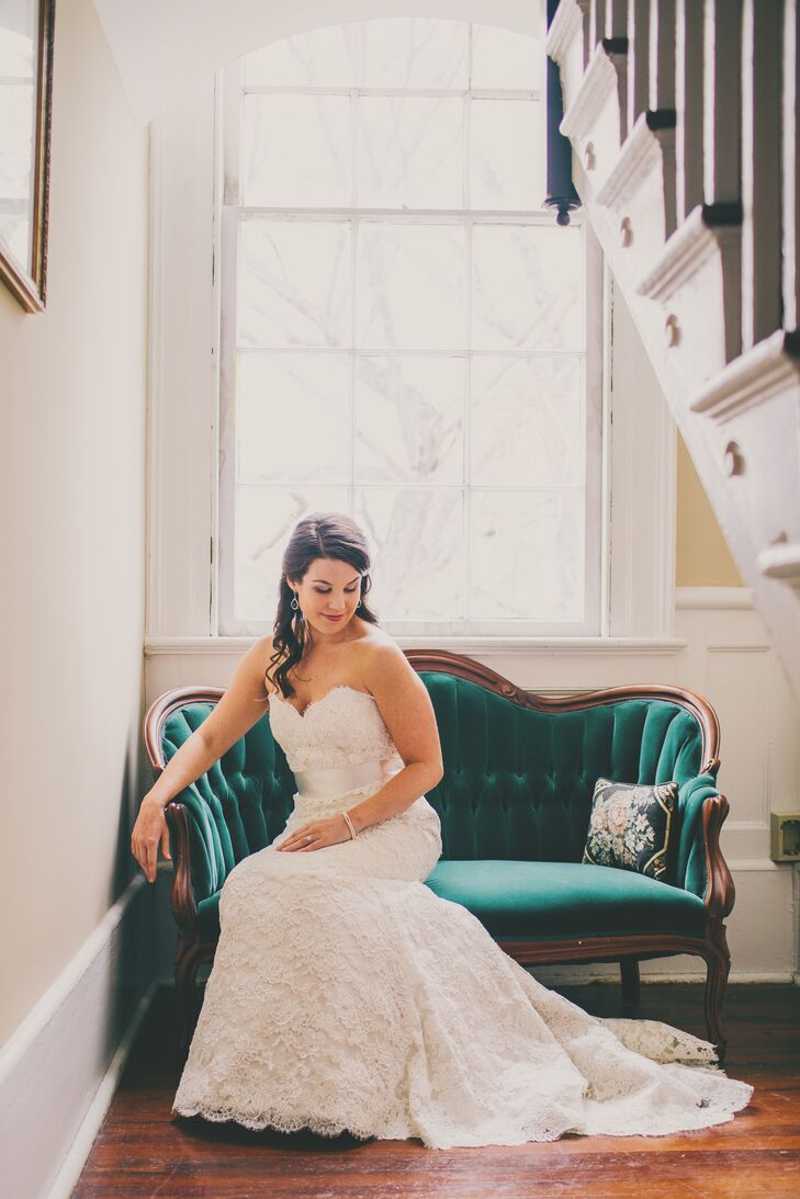"Katie was a classic beauty in her ivory lace, Alvina Valenta fit-and-flare gown. ""I modified it a bit, so the long sash that came with it was cut and shortened to instead fit more like a belt,"" she says. The look was completed with a long, dramatic butterscotch-colored veil."