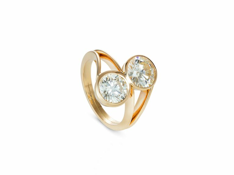 two stone ring in bezel setting in yellow gold setting
