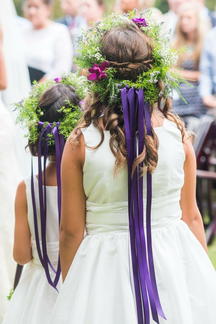 Flower girls wore floral headpieces with purple ribbon attached at the back down the ceremony aisle.