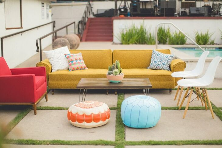 Brightly colored mid-century modern furniture was a relaxing place for guests to rest during the reception.