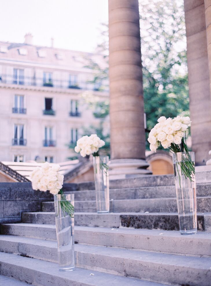 Decorations at the ceremony site were kept minimal. Glass vases filled with white hydrangeas and roses decorated the stone steps of the chapel, where Morgan and Kevin exchanged vows.