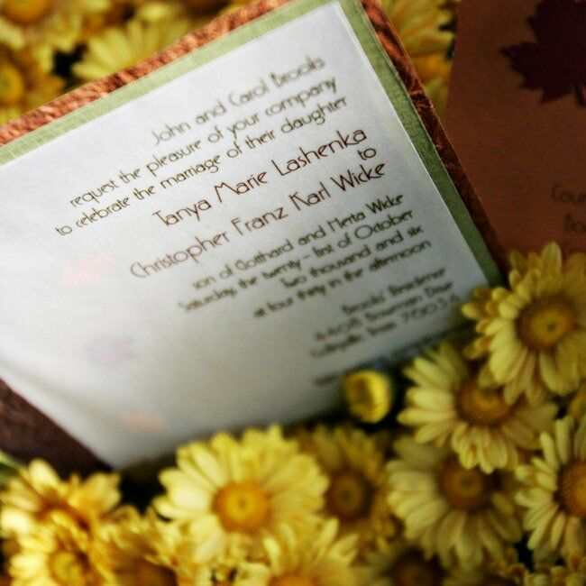 The couple spent hours designing their autumn-inspired invitations. The result was a multilayered card bound on the side with a sage green ribbon.