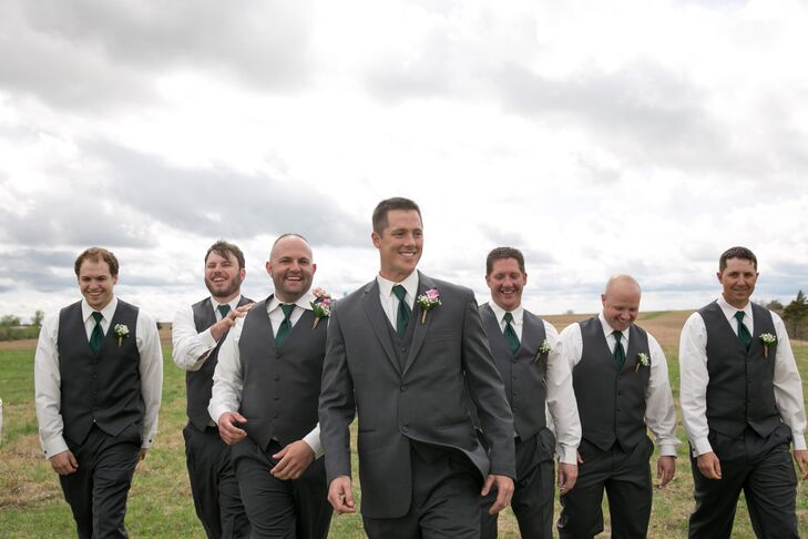 Travis had one request in the planning of the big day: incorporating the color hunter green. The men accessorized their gray suiting with hunter green ties and socks. Travis, unlike the groomsmen, wore a full suit, and adorned the lapel of his coat with a pink calla lily boutonniere.