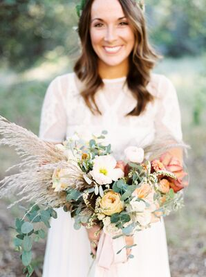 Bohemian Bride with Oversized Bouquet of Wildflowers, Peonies, Grains and Eucalyptus