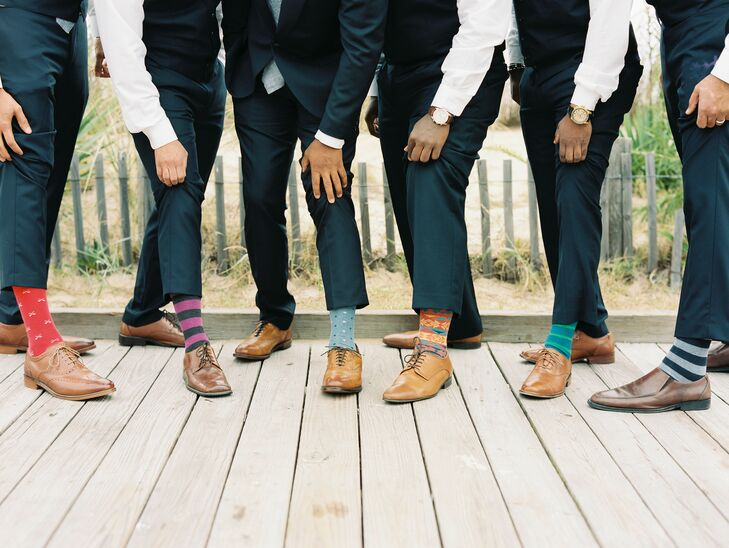 To show a bit of personality, Aaron and his groomsmen wore quirky socks, like a 'Where's Waldo' pair. Aaron's had blue polka dots with red tips.