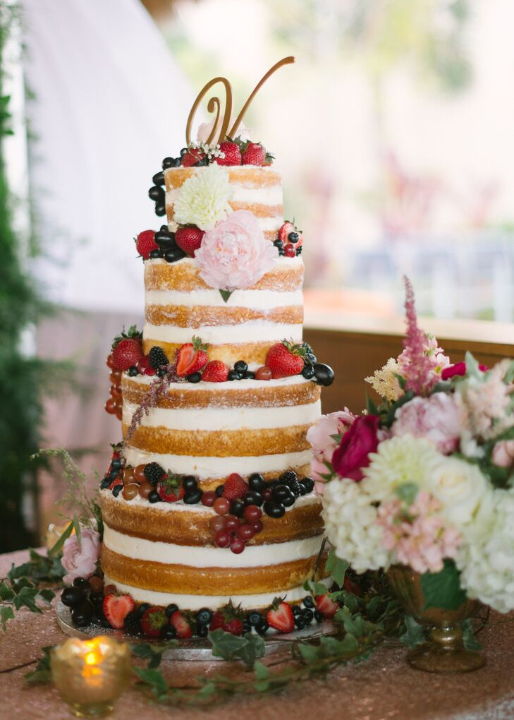 """The cake was a key lime flavor with buttercream frosting,"" Katrina says. Created by Sweet Savannahs, a family friend, the naked cake was draped with berries and flowers and dusted with powdered sugar."