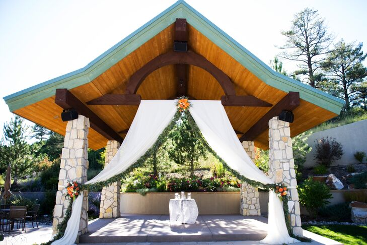 Rustic Wood and Stone Wedding Arbor