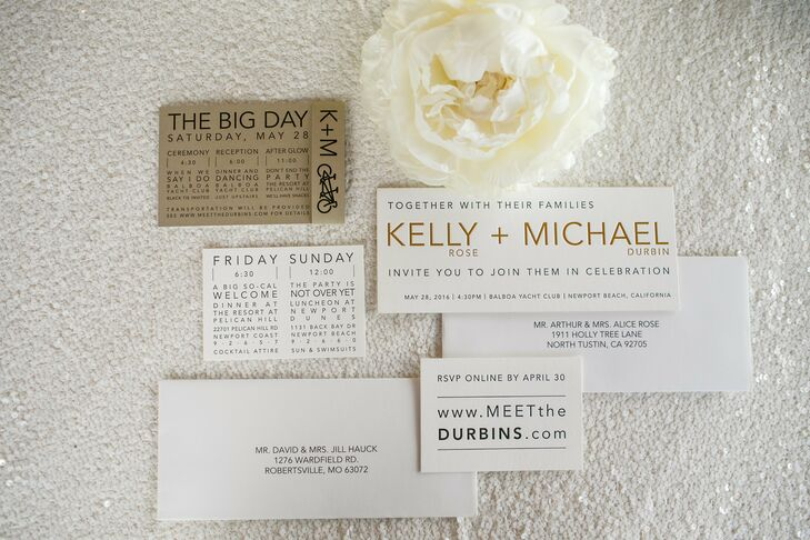 Kelly and Michael's invitation suite was simple, made with gold and black printing. Their wedding logo, a tandem bicycle, was also included in the design.