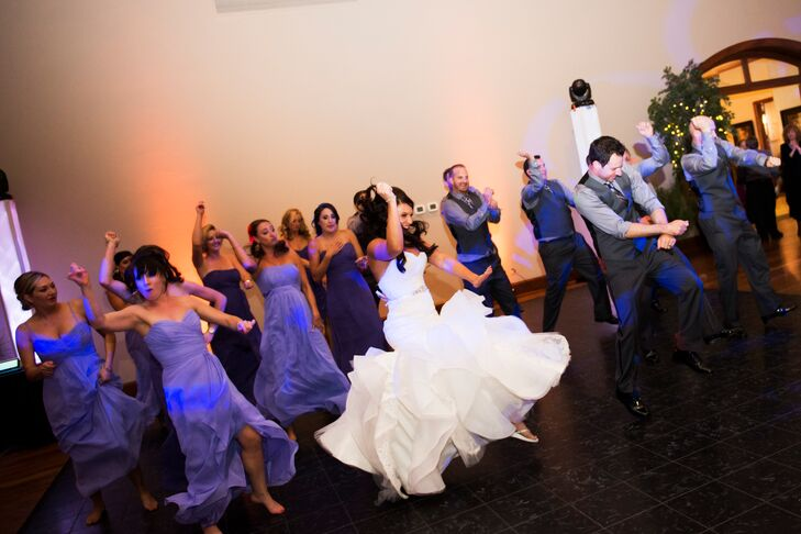 """As a wedding gift, Cara'a cousin hired an old friend to choreograph a group dance at the reception. """"Before the dance began, the DJ announced all 16 wedding party members to silly nicknames (assigned by us!) as if they were a basketball team while playing 'Sirius' by the Alan Parsons Project in the background,"""" Cara says. """"When it came to announce the happy couple, we came out across the large ballroom to 'I feel so close to you Right Now' by Calvin Harris. From there, we joined they wedding party on the other side and busted out into a hilarious mob flash. The entire venue went nuts, not expecting it, and it set the tone of fun for rest of the night."""""""