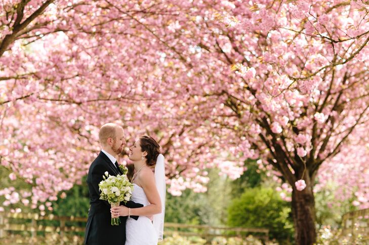 Jamie Delaine Photography took photos of the couple outdoors, underneath gorgeous cherry blossoms trees.