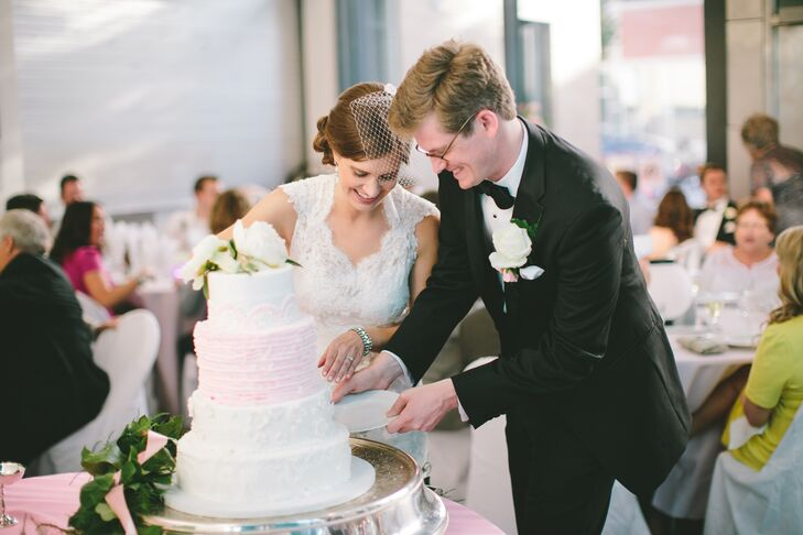 Bella Roca Cakes created Genevieve and Justin's four-tiered pink and white wedding cake for dessert. Inside it was vanilla almond while the outside was decorated with different textured buttercream on each layer. It definitely complemented their classic theme and contemporary venue.
