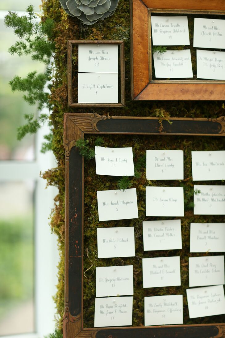 "While the couple kept their escort card design simple and chic with classic ivory card stock and gray hand-lettering, the display was a different story. FleursBella created a living wall with earthy moss and succulents, which they then overlaid with vintage picture frames in various shapes and sizes. The escort cards were arranged within the confines of each frame. ""I had never seen anything like it,"" Lauren says. ""It was amazing."""