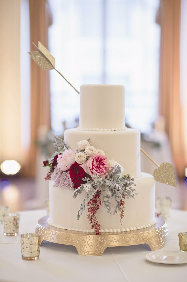 Instead of a topper, the baker placed a gold arrow through two of the wedding cake tiers -- a subtle nod to the Valentine's Day wedding date.