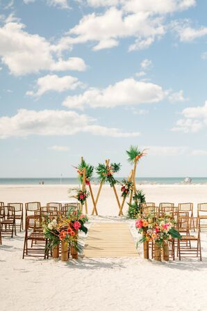 Beach Wedding Ceremony With Bamboo Folding Chairs and Dramatic Backdrop