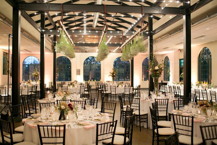 """""""I had a vision to have baby's breath hung from the rafters of the dance floor and worked with my florist to have it executed,"""" Jessica says. """"It wasn't an easy project, but they worked hard and it was beautiful. It was a perfect touch to my bohemian and romantic look for my reception."""""""