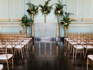 Modern Ceremony Site with Gold Chairs and Tropical Leaves