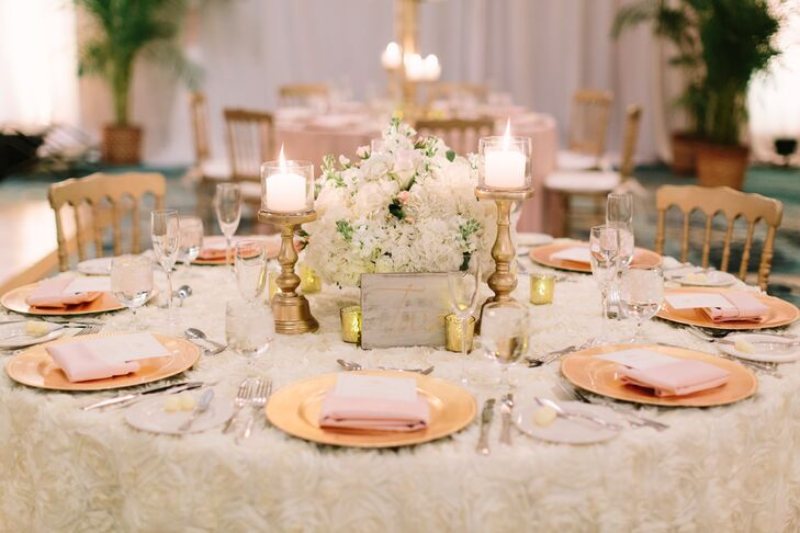 Gold Candlestick and White Floral Centerpiece
