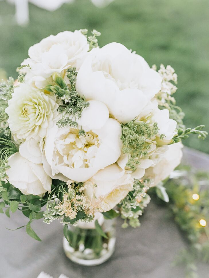 """St. Ive's Florist designed the bridal and bridesmaid bouquets. """"For my bouquet, I knew I had to have peonies, tulips and hydrangeas because those are my three favorite flowers,"""" Kaasi says. """"I did all white with greenery for the colors and the beauty."""""""