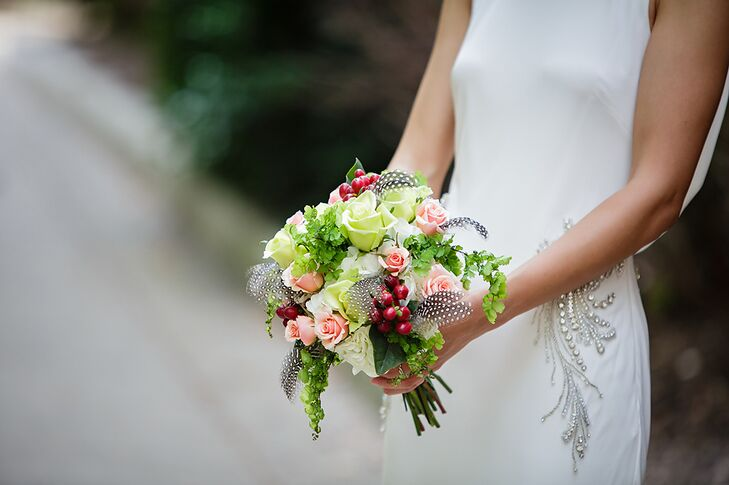 The bride designed her own bouquet, which was made of white hydrangeas, green roses and maidenhair fern.