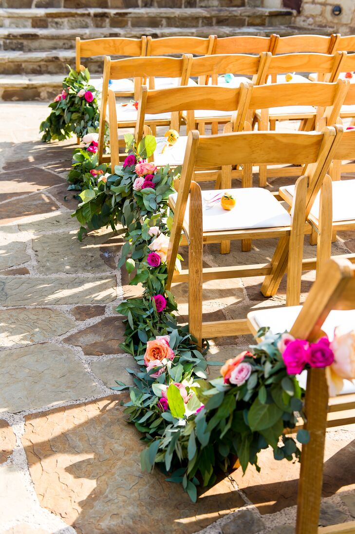 The bold floral choice also spilled over to the wooden chairs at the ceremony, as garland peppered with beautiful buds draped the outdoor affair.