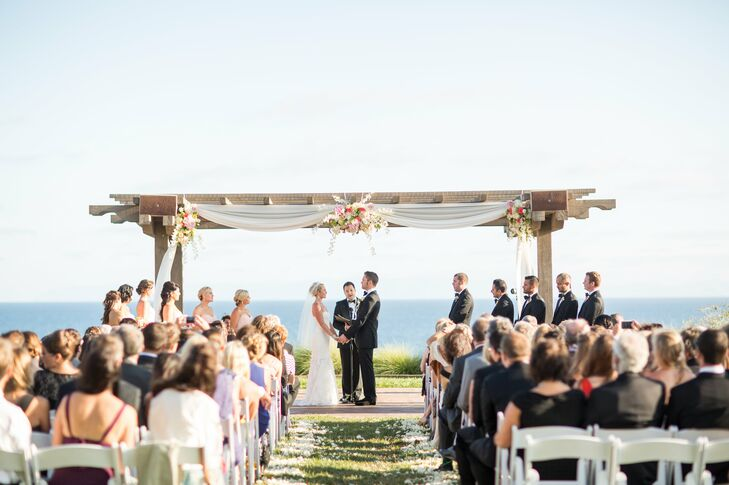 Bride and Groom at the Wooden Trellis Altar