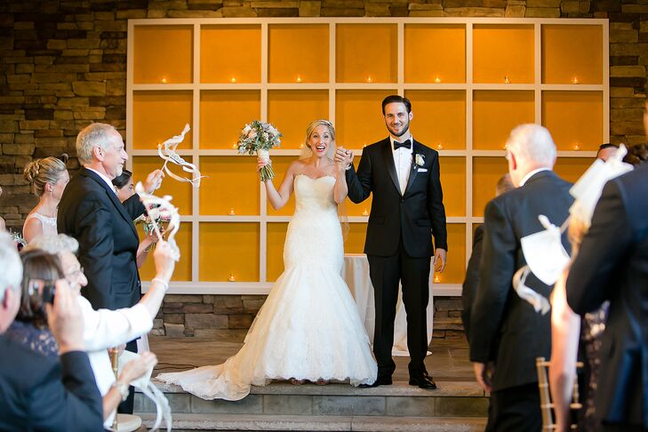 The couple was married outside at Stone House at Stirling Ridge in front of a warm orange backdrop accented with twinkling votives.