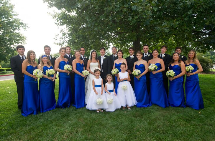 The bridesmaids matched in strapless cobalt blue gowns with green hydrangea bouquets.