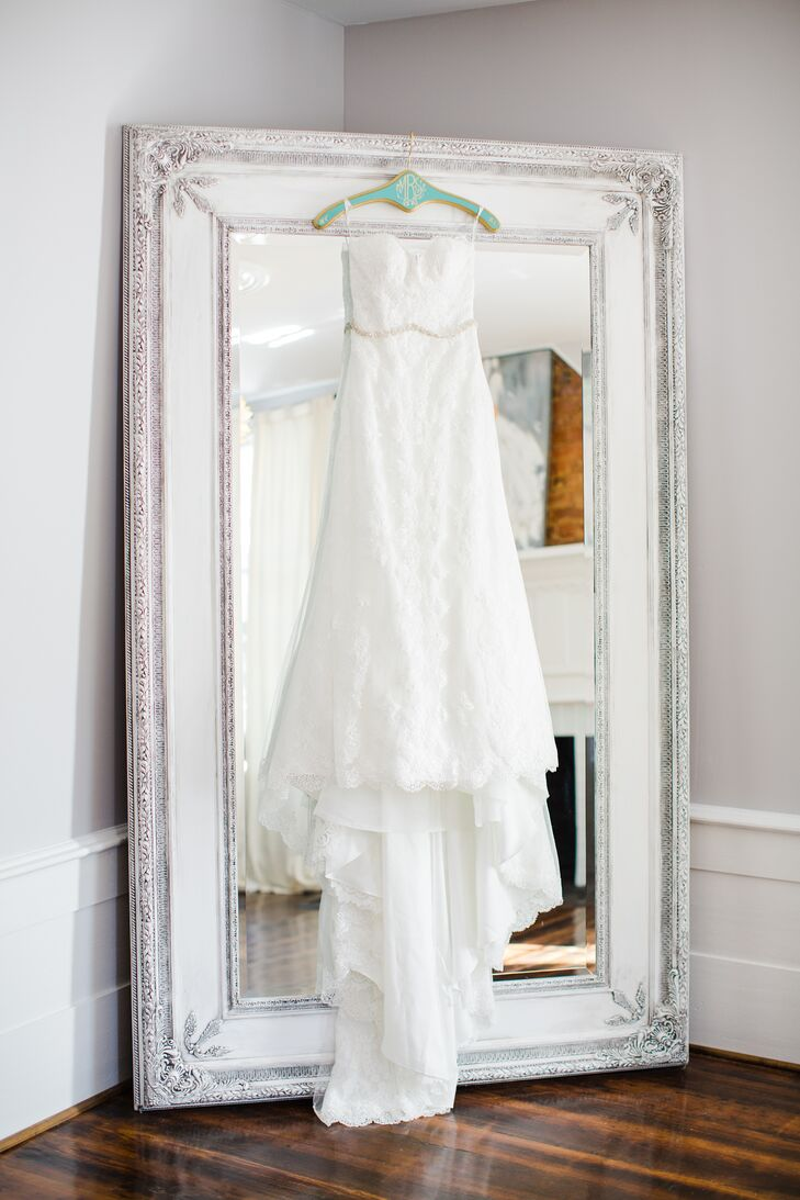 """I knew I wanted lace—I love the Southern and sweet look it provides,"" Allison says. She decided on a fitted-body style to accent her curves and an ivory fabric (instead of white) to match her fair complexion."