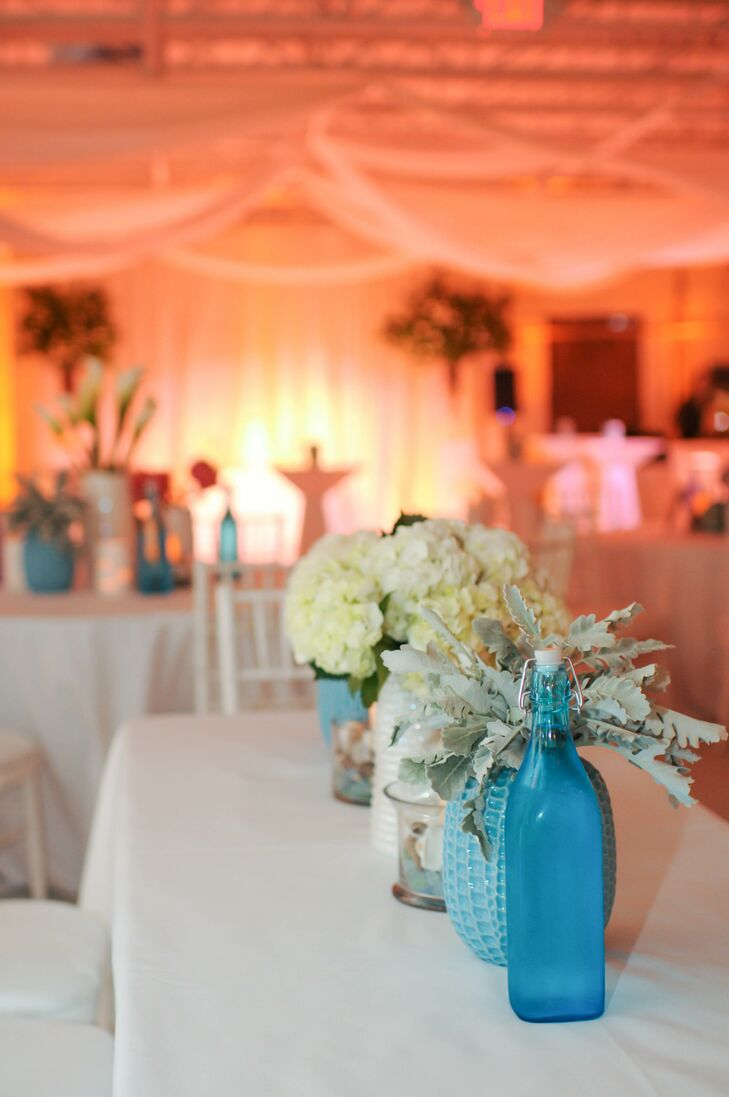 Dusty Miller and Hydrangea Centerpieces in Colorful Vases