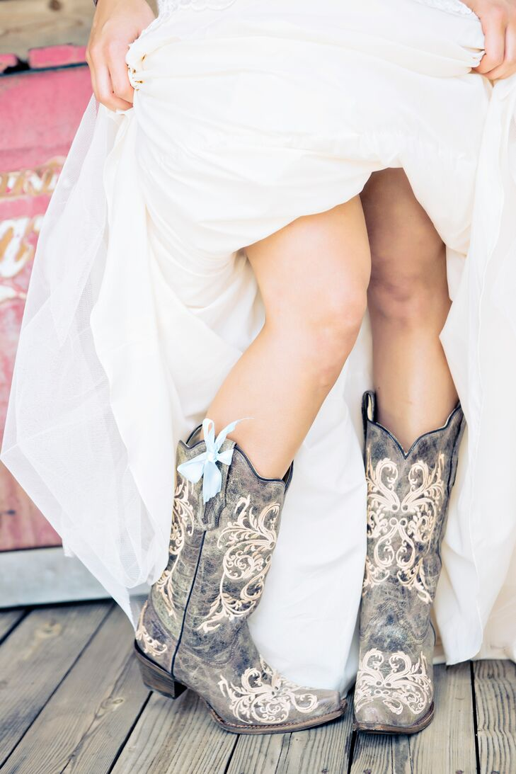 "To complete her rustic style, Samantha wore cowboy boots under her dress. A light blue bow on one boot added a ""something blue"" to her outfit."