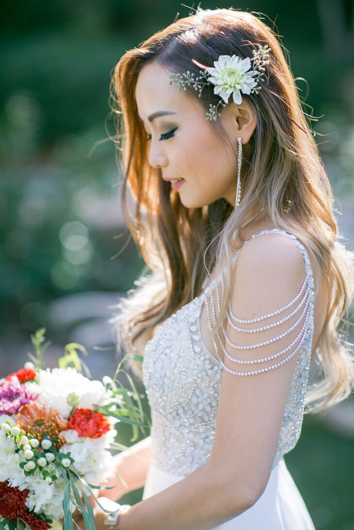 Lisa, a fashion designer, found her gown online and customized it by adding a bejeweled rhinestone shoulder piece and pearls and beads on the bodice.