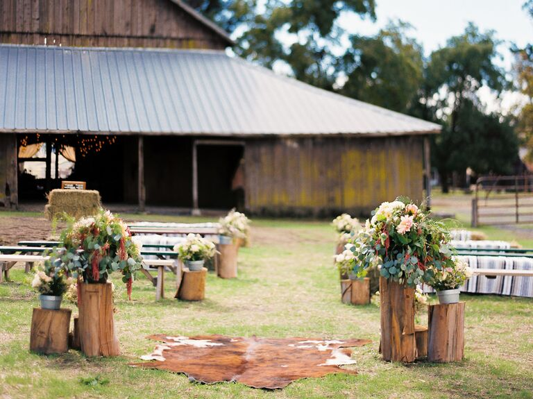 Recycled Tree Stumps and Flower Arrangements wedding aisle decor