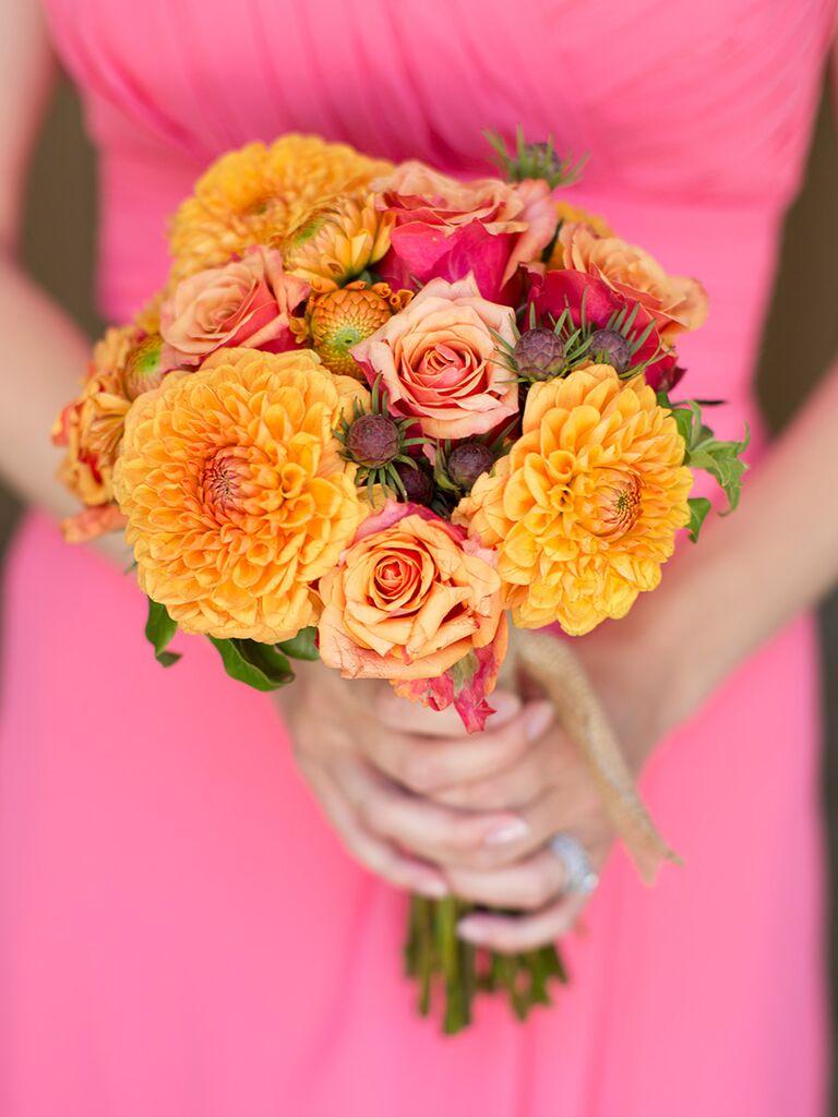 Orange bridesmaid bouquet with dahlias and roses