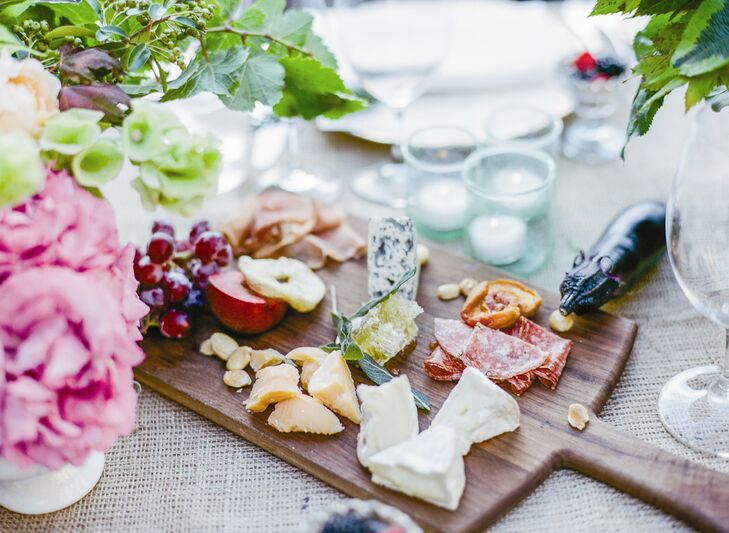 Charcuterie boards piled high with cheeses, meats and fruits were placed at each table to create a family style dining experience.