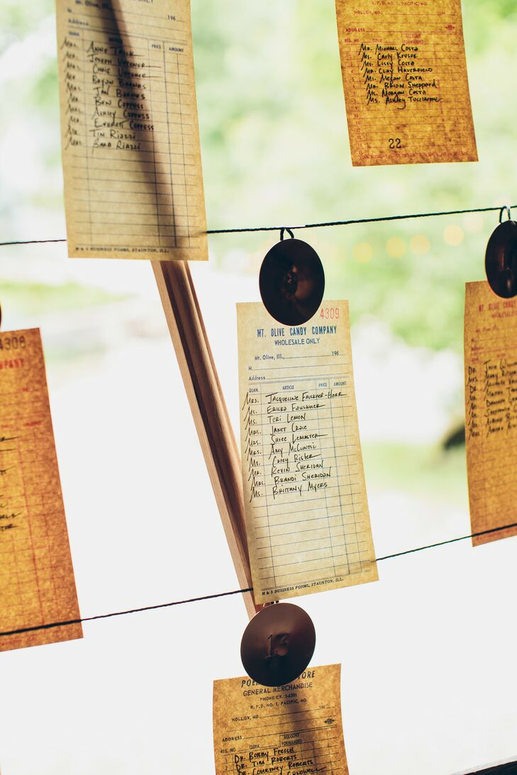 Rustic Escort Card Display with Vintage Receipt Place Cards
