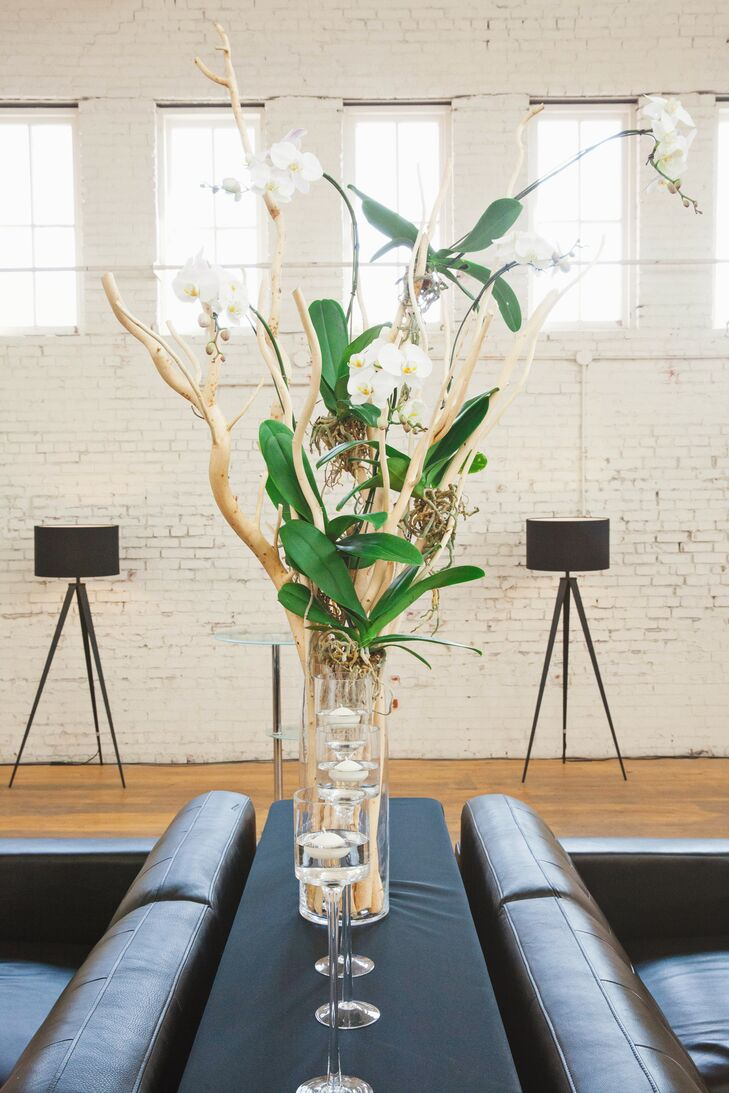 """""""We wanted the wedding to be masculine and modern, so we chose a neutral palette of black, grey and glass,"""" says Jason B. """"We had just a few accent pieces as far as flowers went. We chose white orchids to go along with the neutral color palette."""""""