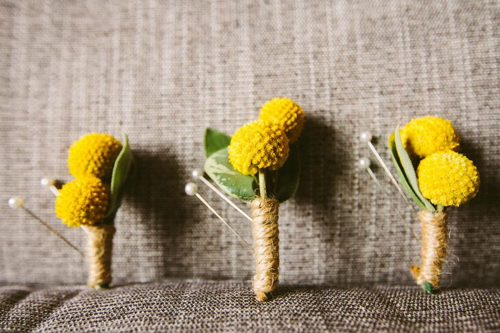 The groom and his attendants wore simple billy ball boutonnieres wrapped in twine.