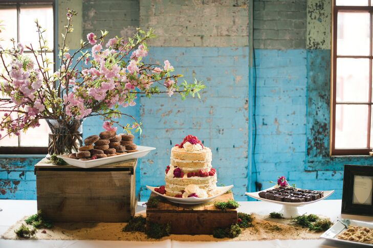 """While 111 Maine's menu of everything from mini lobster rolls to fish tacos with blueberry-mango slaw went over big with the couple's guests, the cake received rave reviews. """"I love coconut and the look of naked cakes, so those were my only requests,"""" says Lauren. The couple's catering team delivered with a decadent coconut-raspberry confection, plus an assortment of miniature desserts including strawberry rhubarb tartlets."""