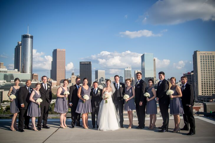 The bridesmaids wore gray dresses with a purple undertone, which went with a variety of skin tones. The groomsmen wore classic black suits to match the formal atmosphere.
